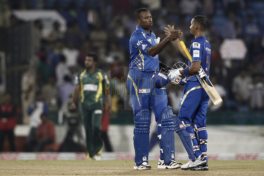 Lendl Simmons , Kieron Pollard of the Mumbai Indians celebrates his win against Southern Expressduring the qualifier 4 match of the Oppo Champions League Twenty20 between the Mumbai Indians and the Southern Express held at the Chhattisgarh International Cricket Stadium, Raipur, India on the 14th September 2014<br /> <br /> Photo by:  Deepak Malik / Sportzpics/ CLT20<br /> <br /> <br /> Image use is subject to the terms and conditions as laid out by the BCCI/ CLT20.  The terms and conditions can be downloaded here:<br /> <br /> http://sportzpics.photoshelter.com/gallery/CLT20-Image-Terms-and-Conditions-2014/G0000IfNJn535VPU/C0000QhhKadWcjYs