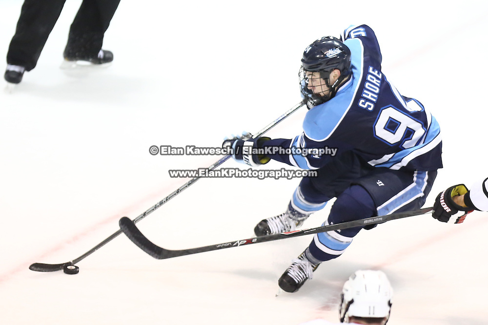 Devin Shore #94 of the Maine Black Bears controls the puck during the game at Matthews Arena on February 22, 2014 in Boston, Massachusetts. (Photo by Elan Kawesch)