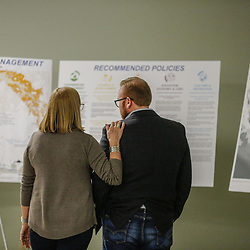 Mathew Sanders (right) with the offices of community development and Bobbie Hill of Concordia look over LA Safe project boards during a community meeting in Mathews,  Louisiana, U.S., on Monday, December 18, 2017. Louisiana is preparing recommendations through projects with LA Safe for emptying out coastal areas that are unprotected by levees and will be impacted by sea level rise in the coming years. Photographer: Derick E. Hingle/Bloomberg