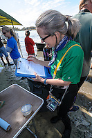 Manatee Health Assessments, Kings Bay, Crystal River, Citrus County, Florida USA. November 10, 2011 pm. Researchers from several federal and state agencies and other partners work together to gather data during the manatee capture and health assessments. Cathy Beck, Wildlife Biologist with US Geological Survey's Sirenia Project, documents various manatee data on an official form.
