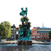 Water fountain outside the train station in Uppsala is the fourth largest city of Sweden, and home to Uppsala University the oldest centre of higher education in Scandinavia.<br /> Photography by Jose More