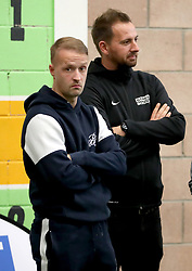Celtic's Leigh Griffiths (left) and Street Soccer founder and CEO David Duke watch from the side of the pitch as the men and women Street Soccer teams take part in a special training session at Lennoxtown, Glasgow.