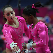 Jordyn Wieber, (left) and Gabrielle Douglas, USA, prepare for the uneven bars during the Women's Artistic Gymnastics podium training at North Greenwich Arena during the London 2012 Olympic games preparation at the London Olympics. London, UK. 26th July 2012. Photo Tim Clayton