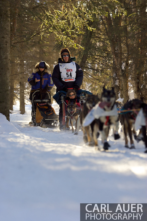 March 7th, 2009:  Anchorage, Alaska - Ken Anderson of Fairbanks takes his team through the woods near the Alaska Native Hospital during the ceremonial start of the 37th Iditarod.