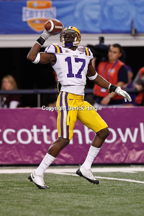 Jan 7, 2011; Arlington, TX, USA; LSU Tigers cornerback Morris Claiborne (17) makes a one handed grab during warm ups prior to kickoff of the 2011 Cotton Bowl against the Texas A&M Aggies at Cowboys Stadium. LSU defeated Texas A&M 41-24.  Mandatory Credit: Derick E. Hingle