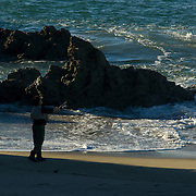 Man fishing on the beach. Pacific Coast Highway. Camarillo,CA.USA.