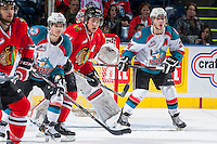 KELOWNA, CANADA - APRIL 25: Kris Schmidli #16 and Tyson Baillie #24 of the Kelowna Rockets look for the pass as they check Derrick Pouliot #51 of the Portland Winterhawks on April 25, 2014 during Game 5 of the third round of WHL Playoffs at Prospera Place in Kelowna, British Columbia, Canada. The Portland Winterhawks won 7 - 3 and took the Western Conference Championship for the fourth year in a row earning them a place in the WHL final.  (Photo by Marissa Baecker/Getty Images)  *** Local Caption *** Tyson Baillie; Kris Schmidli; Derrick Pouliot;