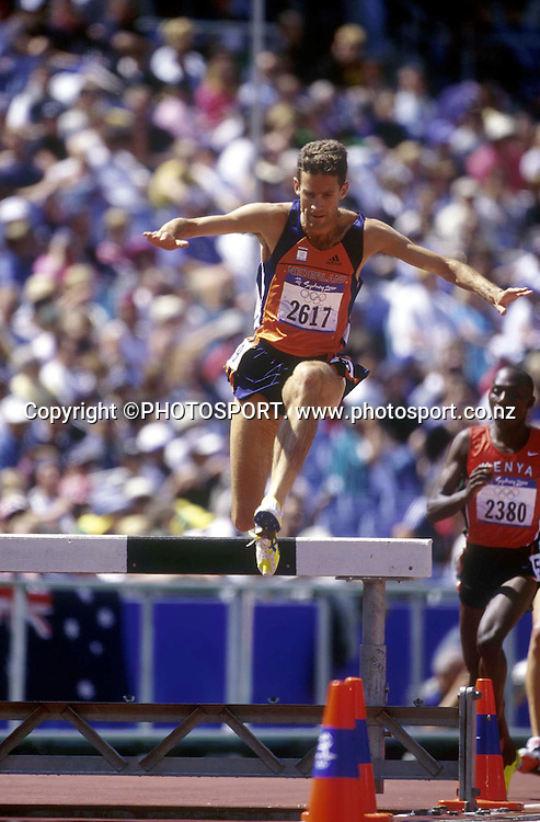 Simon Vroemen of the Netherlands in action during the Mens 3000m steeple chase at the Sydney Olympic Games, on September 27 2000. Photo: PHOTOSPORT<br /><br /><br />steeplechase track and field jump hurdle athletics