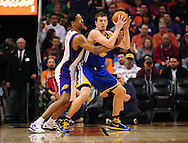 Feb. 22, 2012; Phoenix, AZ, USA;  Golden State Warriors forward David Lee (10) is guarded by the Phoenix Suns forward Channing Frye (8) during the first half at the US Airways Center.  The Warriors defeated the Suns 106 - 104. Mandatory Credit: Jennifer Stewart-US PRESSWIRE.