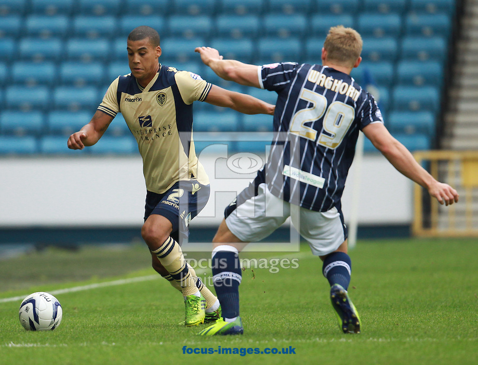 Picture by John Rainford/Focus Images Ltd +44 7506 538356<br /> 28/09/2013<br /> Martyn Waghorn of Millwall and Lee Peltier of Leeds United during the Sky Bet Championship match at The Den, London.