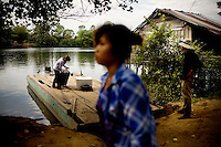 A river taxi arrives in the community-based ecotourism village of Chi Phat, located on the Preak Piphot River, in the Southern Cardomom Protected Forest, in Koh Kong Province, Cambodia, on Thursday, Dec. 3, 2010.