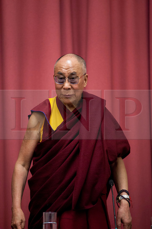 © Licensed to London News Pictures. 19/06/2012. LONDON, UK. His Holiness the Dalai Lama is seen at the University of Westminster's Oxford Street campus after giving a talk on the values of democracy and Tibet in London today (19/0612). The talk came as part of the Dalai Lama's visit to London to spread a message of non-violence, dialogue and universal responsibility, particularly to young people.. Photo credit: Matt Cetti-Roberts/LNP