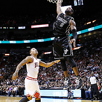 29 January 2012: Miami Heat shooting guard Dwyane Wade (3) dunks the ball past Chicago Bulls point guard Derrick Rose (1) during the Miami Heat 97-93 victory over the Chicago Bulls at the AmericanAirlines Arena, Miami, Florida, USA.