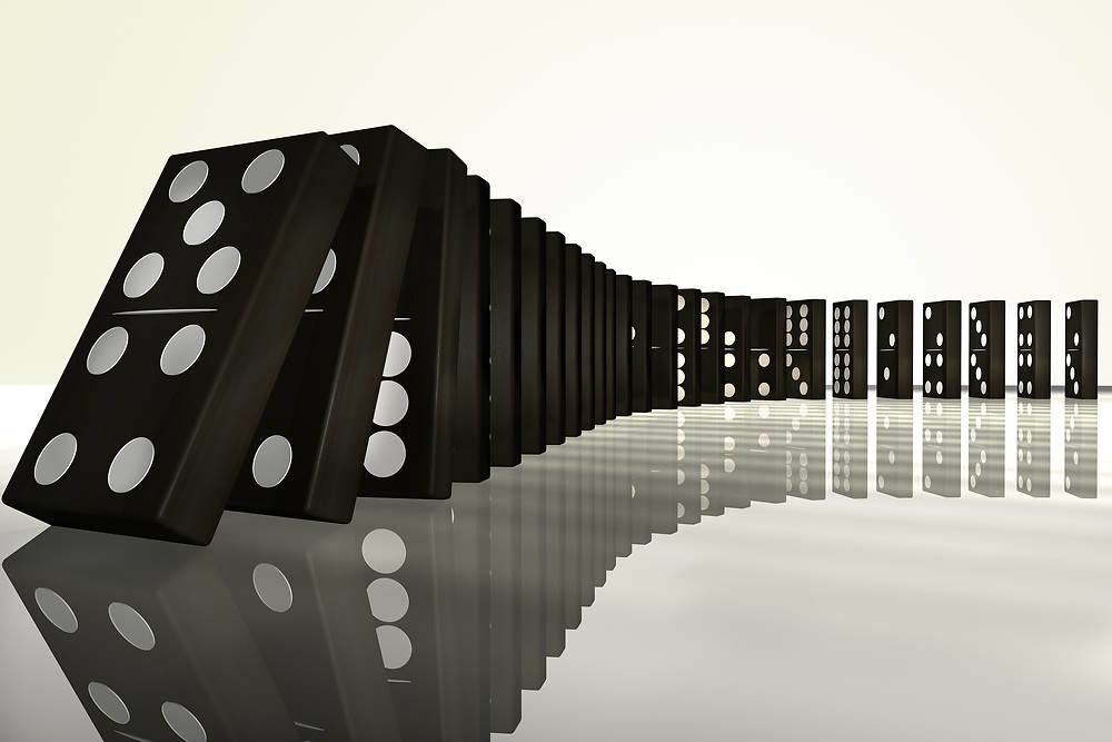 3D rendering of a row of falling dominoes