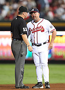 ATLANTA, GA - SEPTEMBER 02:  Atlanta Braves manager Fredi Gonzalez #33 argues with second base umpire Tony Randazzo #11 during the game against the Los Angeles Dodgers at Turner Field on September 2, 2011 in Atlanta, Georgia.  (Photo by Mike Zarrilli/Getty Images)