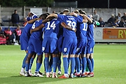 AFC Wimbledon team huddle during the EFL Sky Bet League 1 match between AFC Wimbledon and Bradford City at the Cherry Red Records Stadium, Kingston, England on 2 October 2018.