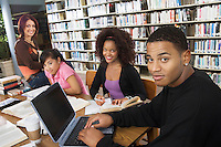 College students studying together in library