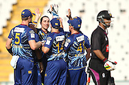 James McMillan of Otago Volts is congratulated by his team mates after getting Ammar Mahmood Khan of the Faisalabad Wolves wicket during the Qualifier 1 match of the Karbonn Smart Champions League T20 (CLT20) between Otago Volts and the Faisalabad Wolves held at the Punjab Cricket Association Stadium, Mohali on the 17th September 2013<br /> <br /> Photo by Shaun Roy/CLT20/SPORTZPICS<br /> <br /> <br /> Use of this image is subject to the terms and conditions as outlined by the CLT20. These terms can be found by following this link:<br /> <br /> http://sportzpics.photoshelter.com/image/I0000NmDchxxGVv4<br /> <br /> ENTER YOUR EMAIL ADDRESS TO DOWNLOAD