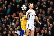 Alex Sandro (12) of Juventus battles for possession with Eric Dier (15) of Tottenham Hotspur during the Champions League match between Tottenham Hotspur and Juventus FC at Wembley Stadium, London, England on 7 March 2018. Picture by Graham Hunt.