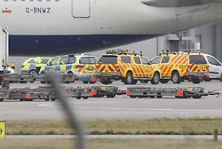 © Licensed to London News Pictures. 14/02/2018. London, UK. Police and airport vehicles are seen in the tarmac at Heathrow Airport after this morning's incident near T5.Photo credit: Peter Macdiarmid/LNP