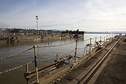 Water flows as the caisson is re-opened on Dry Dock number 3  located on Mare Island in Vallejo, Calif.  California Dry Dock Solutions was recently awarded a $3.1 Million contract from the U.S.Navy to dismantle two ships currently located in Suisun Bay