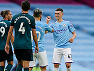Phil Foden of Manchester City celebrates scoring the first goal with Sergio Aguero of Manchester City during the Premier League match at the Etihad Stadium, Manchester. Picture date: 22nd February 2020. Picture credit should read: Andrew Yates/Sportimage