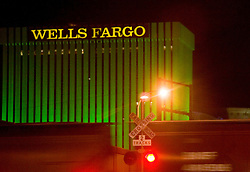 A freight train speeds past the Wells Fargo building in downtown Albuquerque, NM<br />