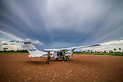 Clouds form over Yei, South Sudan as the local kids greet the plane.