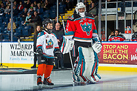 KELOWNA, CANADA - NOVEMBER 29: The seventh player of the game stands on the blue line next to James Porter #1 of the Kelowna Rockets against the Prince George Cougars on November 29, 2017 at Prospera Place in Kelowna, British Columbia, Canada.  (Photo by Marissa Baecker/Shoot the Breeze)  *** Local Caption ***