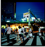 Young Tokyites head for Kabuki Cho, the entertainment district, a restaurant district and also the largest red light district in Asia.  All mingle together.  Shinjuku, Tokyo, Japan.