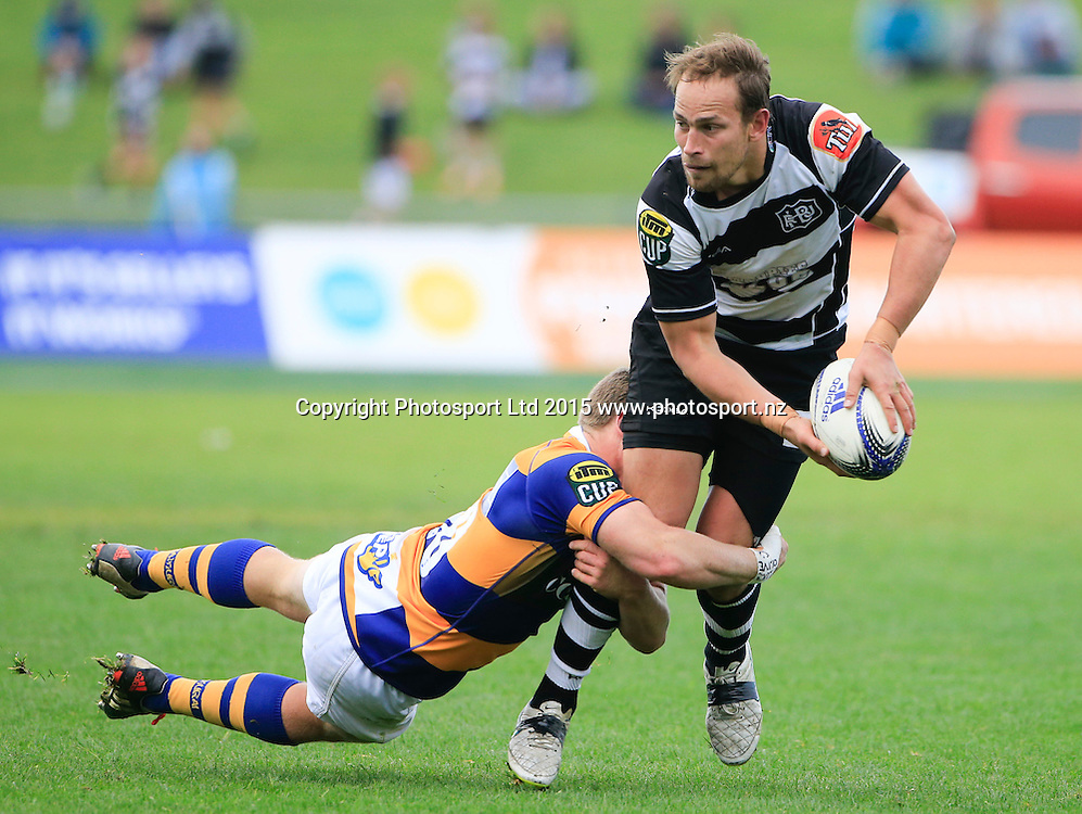 Andrew Horrell passes in the tackle. Ranfurly Shield Challenge, ITM Cup, Hawkes Bay v Bay of Plenty, Napier, New Zealand. Saturday 19 September, 2015. Copyright photo: John Cowpland / www.photosport.nz