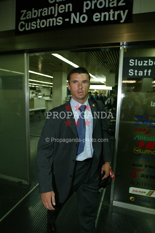 BELGRADE, SERBIA & MONTENEGRO - Monday, August 18, 2003: Wales' Gary Speed arrives at Belgrade Airport ahead of his side's UEFA European Championship Group 9 qualifying match against Serbia & Montenegro. (Photo by David Rawcliffe/Propaganda)
