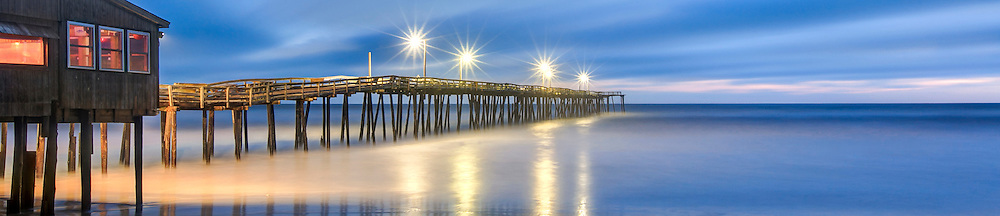 Nags Head Fishing Pier lights turn to stars from using a small aperture camera setting at twilight.