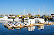 Picturesque Newport Harbor, Rhode Island, with docks, fishing boats, small sailbaots and dinghies on dock
