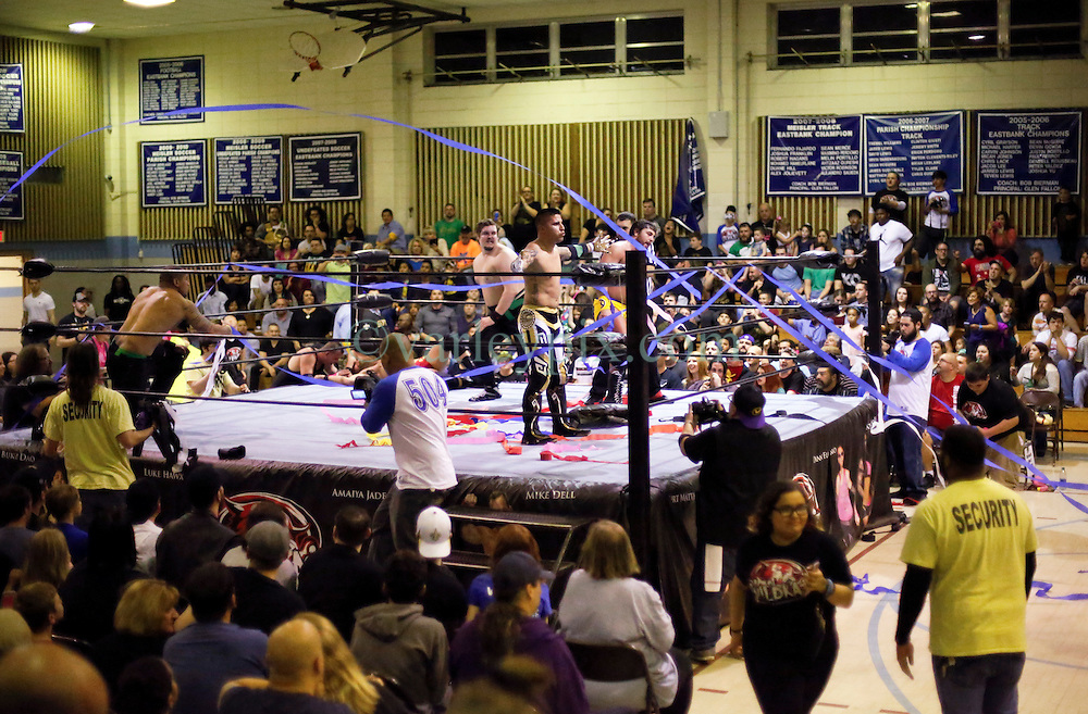 12 March 2016. Metairie, Louisiana.<br /> Wrestling action from Wildkat Sports and Entertainment's 'March into Mayhem' at the Meisler Middle School. Alex Cruz and 'Mr. Xcellence' Brandon Scott defeat 'Chalmation Sensation' Danny Flamingo and Ken Dixon<br /> Photo©; Charlie Varley/varleypix.com