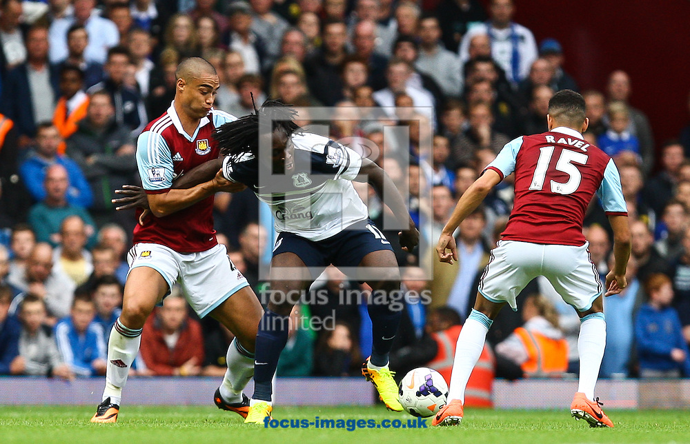 Picture by Daniel Chesterton/Focus Images Ltd +44 7966 018899<br /> 21/09/2013<br /> Winston Reid of West Ham United and Romelu Lukaku of Everton compete for the ball during the Barclays Premier League match at the Boleyn Ground, London.