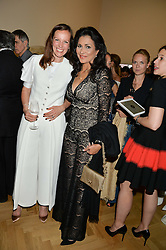 Left to right, BRITA FERNANDEZ SCHMIDT and LADY FORSYTH at a private view and auction of millinery organised by author, philanthropist and hat collector Eva Lanska in aid of Women for Women International held at Pace, Burlington Gardens, London on 10th June 2015.