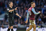 Andrew Madley (Referee) & Jack Grealish (Capt) (Aston Villa) during the Premier League match between Brighton and Hove Albion and Aston Villa at the American Express Community Stadium, Brighton and Hove, England on 18 January 2020.