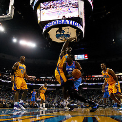 December 10, 2010; New Orleans, LA, USA; Oklahoma City Thunder forward Kevin Durant (35) drives past New Orleans Hornets center Emeka Okafor (50) during the first half at the New Orleans Arena.  Mandatory Credit: Derick E. Hingle-US PRESSWIRE