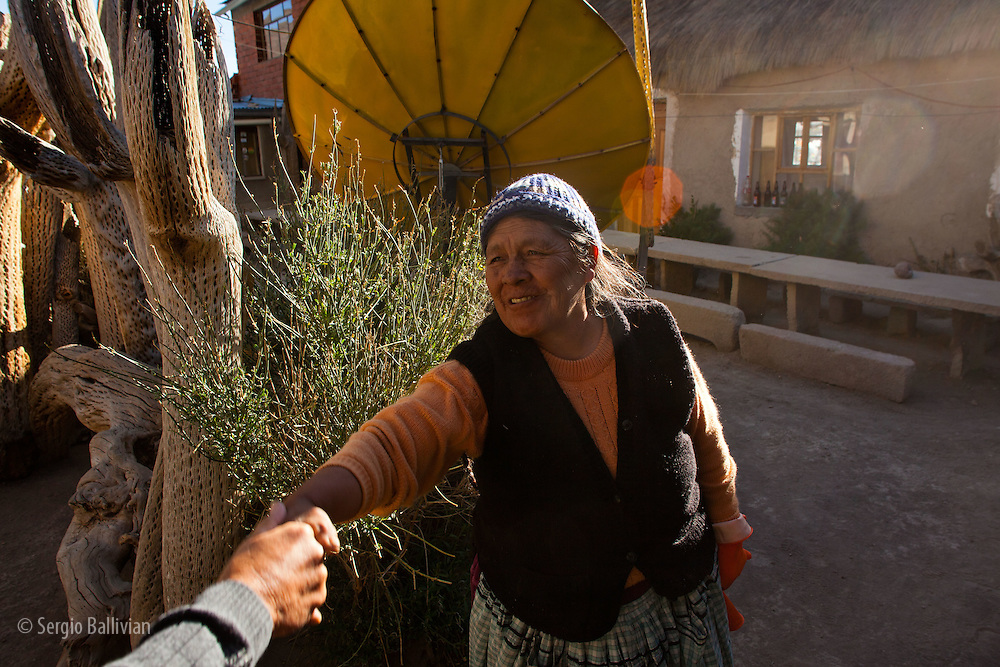 Dona Lupe greets people at her Posada in the village of Jirira, Potosi, Bolivia.