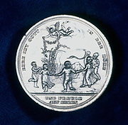 Medal commemorating the discovery of vaccination in 1796. Edward Jenner (1749-1823) practiced as a country doctor in his native Gloucestershire. He noted the  immunity to smallpox given by cow-pox. In 1796 he vaccinated James Phipps a number of times with pus from cow-pox pustules on a dairy maid. He then inoculated him with smallpox. The  boy was ill for a few days, then recovered. Children dancing round garlanded cow.  Obverse of a commemorative medal issued in 1800.