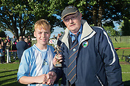 Grenville Dawson secretary of the Dundee Schools Football Association presents the Logie Cup man of the match award to Grove's Nathan Chew - Grove (blue and white) v. Harris (red) in the U13 Logie Cup Final  (sponsored by DFCSS) at Whitton Park, Dundee, Photo: David Young<br /> <br />  - &copy; David Young - www.davidyoungphoto.co.uk - email: davidyoungphoto@gmail.com