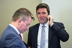 © Licensed to London News Pictures . 09/08/2016 . Salford , UK . ANDY BURNHAM MP on the phone after learning he is selected as Labour's candidate in the race to be the Mayor of Greater Manchester . He and fellow candidates Ivan Lewis and Tony Lloyd were at an event at The Landing in Media City , Salford , for the declaration . Photo credit : Joel Goodman/LNP