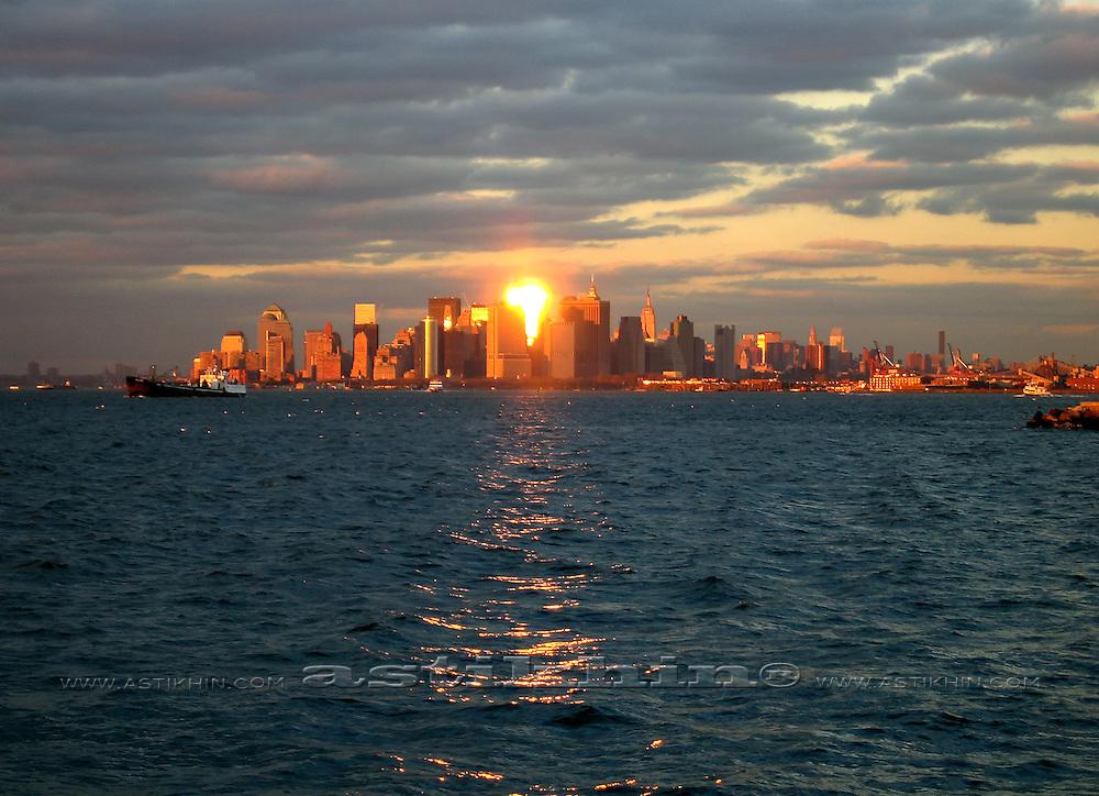 Reflection of sun in windows of Manhattan