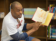 Ellis Wyms reads to students during a Touchdown Houston Read On literacy program at Ross Elementary School, December 2, 2016.