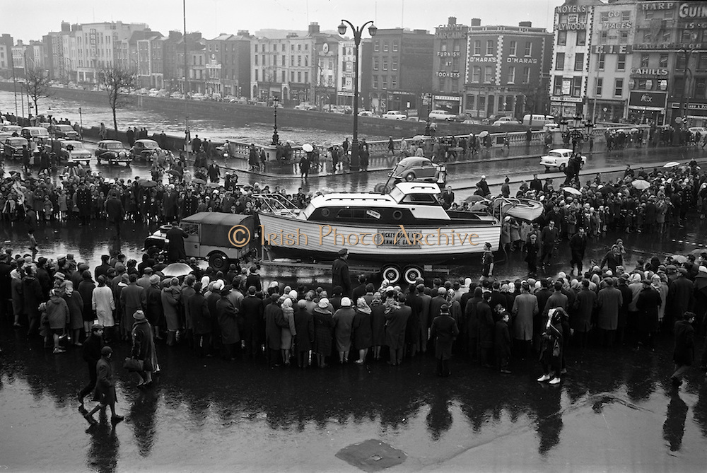 17/03/1964<br /> 03/17/1964<br /> 17 March 1964<br /> St. Patrick's Day Parade, Dublin.  Hickey Boats (Galway) in the parade passing across O'Connell Bridge.
