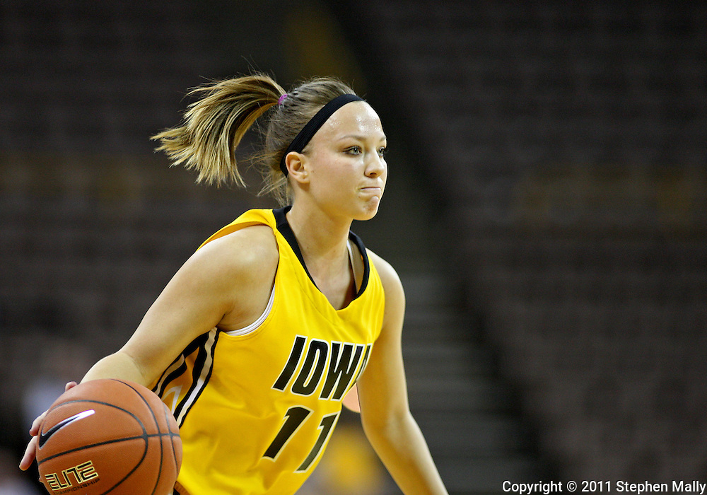 January 27 2010: Iowa guard Trisha Nesbitt (11) with the ball during the first half of an NCAA women's college basketball game at Carver-Hawkeye Arena in Iowa City, Iowa on January 27, 2010. Iowa defeated Michigan State 66-64.
