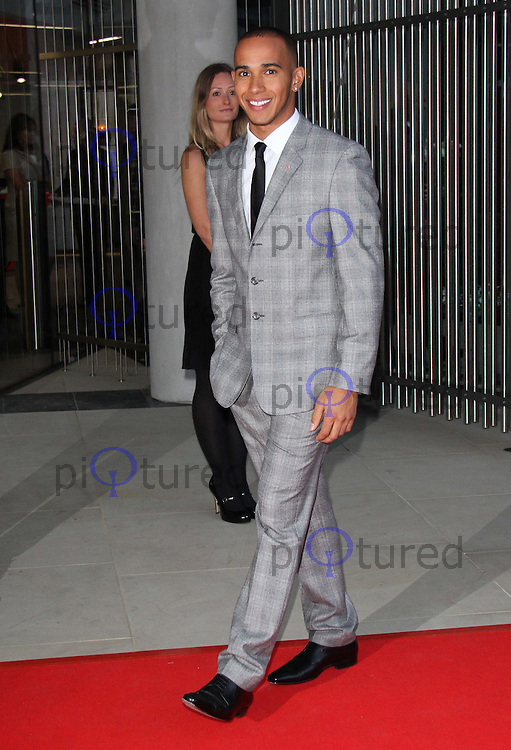 Lewis Hamilton VIP party celebrating the opening of McLaren's flagship London showroom. One Hyde Park, Knightsbridge, London, UK, 21 June 2011:  Contact: Rich@Piqtured.com +44(0)7941 079620 (Picture by Richard Goldschmidt)
