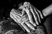 "The hands of Alice Mendes,105, and her great-grandniece, Sophie Friend,12, lie intertwined on Alice's lap. The two have always had a powerful connection and have been pen pals for the past few years. Alice, who despite her age, remains the adored family matriarch, immigrated to the United States as an infant from Cape Verde in 1910. ""Things were really different back then. No gas stoves, no street lights or traffic lights. I remember my mother getting up early in the morning to start the coal stove so that the house would be warm when we woke up,"" she explains. Alice spent much of her life working as a nanny and housekeeper and married the love of her life, Jimmy Mendes, a professional boxer and fisherman who ended up dying at sea in a storm."