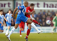 Photo: Olly Greenwood.<br />Colchester United v Coventry City. Coca Cola Championship. 10/03/2007. Colchester's Chis Iwelumo and Coventry's Michael Doyle